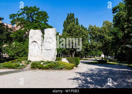 Memorial for the victims of World War II. Caption says: 'For the victims of World War II. In remembrance of the soldiers, citizens, deported. Erected - Stock Photo