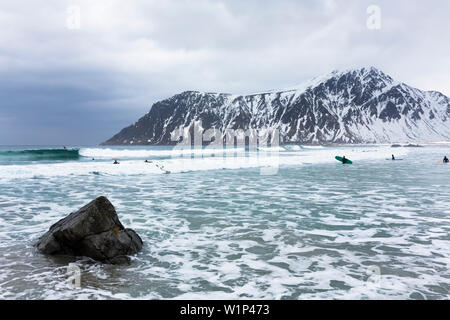 Surfers near Flakstad, Flakstaoya, Lofoten Islands, Norway, Skandinavia, Europe - Stock Photo