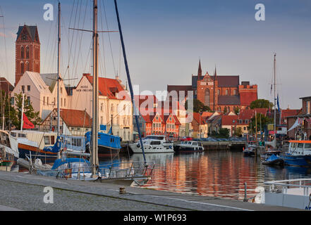 Old port in Wismar with towers of St. Mary's Church, Marienkirche and St. George's Church, Georgenkirche, Mecklenburg Vorpommern, Germany - Stock Photo