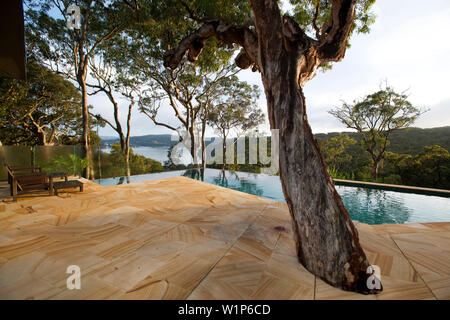 The ininity pool of Pretty Beach House has tremendous views - Stock Photo