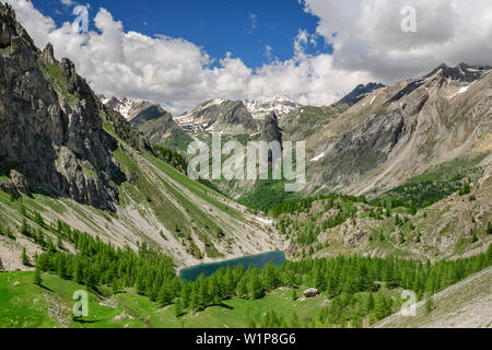 View towards mountain lake and Cottian Alps, Val Maira, Cottian Alps, Piedmont, Italy - Stock Photo