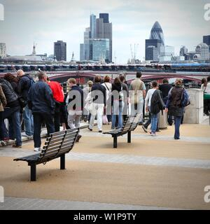 LONDON, UK - MAY 13, 2012: Tourists visit Thames Embankment in London. With more than 14 million international arrivals in 2009, London is the most vi - Stock Photo