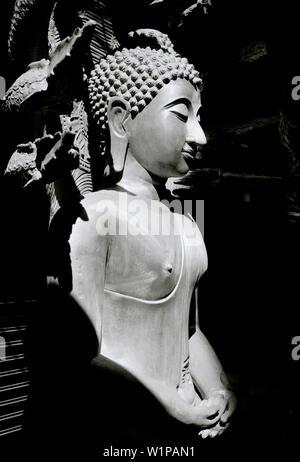 Buddha statues in Bamrung Muang Road in Bangkok in Thailand in Southeast Asia Far East. B&W - Stock Photo