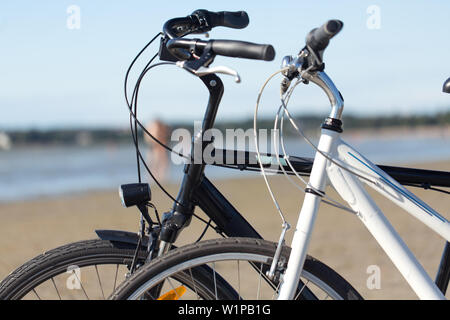close up of two bicycles on beach - Stock Photo