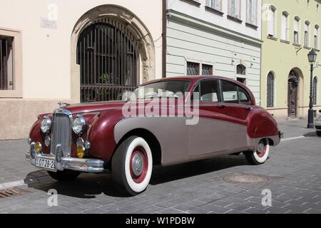 BUDAPEST, HUNGARY - JUNE 20, 2014: Classic Jaguar Mark IX parked in Budapest. It was produced in 1959-1961 as a large luxury car. - Stock Photo