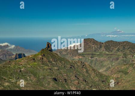 Center of Gran Canaria. Spectacular aerial view across Caldera de Tejeda towards Teide on Tenerife. Famous Roque Bentayga on average and Tenerife abov - Stock Photo