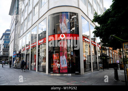 London, UK. 3rd July, 2019. Photo taken on July 3, 2019 shows a Vodafone store in London, Britain. Vodafone UK on Wednesday switched on its 5G service, becoming the second UK mobile operator to turn on its 5G network relying on Huawei equipment. Credit: Alberto Pezzali/Xinhua/Alamy Live News - Stock Photo