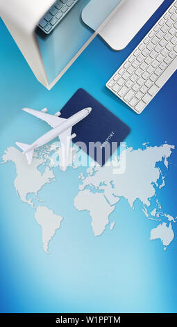 booking and search flight ticket air international travel concept, computer,passport and airplane isolated on blue background with global map - Stock Photo