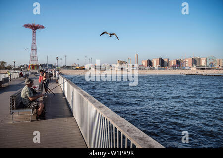 fisherman on Steeplechase Pier on Coney Island beach, Brooklyn, NYC, New York City, United States of America, USA, North America - Stock Photo