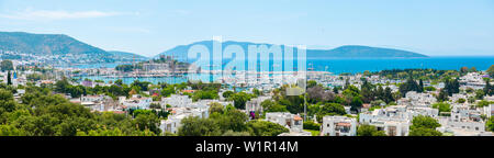 Panoramic View of Aegean sea, traditional white houses marina and Bodrum Castle in Bodrum city or town of Turkey. Colorful street, house and flowers. - Stock Photo