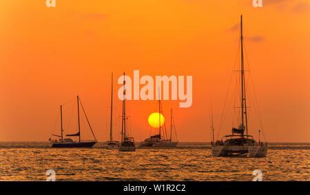 Sunset on Nai Harn Beach Phuket Island Southern Thailand Southeast Asia - Stock Photo