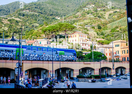 Train arriving at Monterosso al Mare, province of La Spezia, Cinque Terre, Liguria, Italy, Europe - Stock Photo