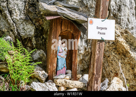 Statue of Holy Mary at fountain Sorgente Pausa, Val Maira, Cottian Alps, Piedmont, Italy - Stock Photo