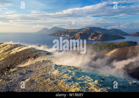 Sulfur on the crater rim of Gran Cratere, view from Vulcano Island to Salina and Lipari, Lipari Islands, Aeolian Islands, Tyrrhenian Sea, Mediterranea - Stock Photo
