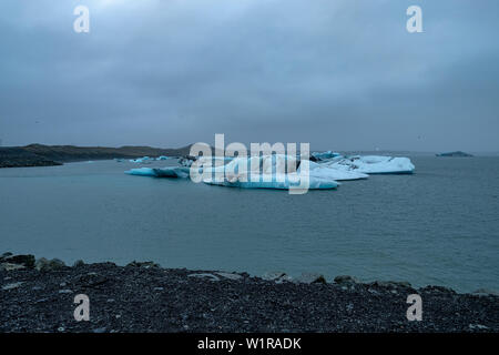 Icebergs floating the Jokulsarlon Glacier Lagoon on a spring day in southeastern Iceland - Stock Photo