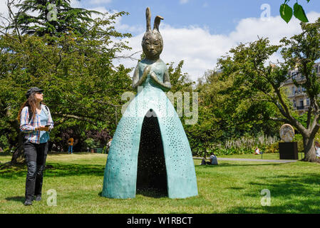 London, UK. 3 July 2019. A woman views 'Usagi Kannon II', 2013-18, by Leiko Ikemura. Frieze Sculpture opens in Regent's Park, London's largest free display of outdoor art.  Works from 23 international artists are on display 3 July to 6 October 2019.  Credit: Stephen Chung / Alamy Live News - Stock Photo