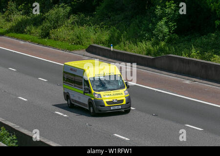 Yellow Private Ambulance Peugeot Boxer 435 L3H2 HDI; UK Vehicular traffic, Private Ambulance transport, modern, north-bound on the 3 lane M6 motorway highway. - Stock Photo