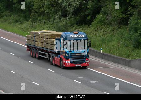 Craig's UK Vehicular traffic, Scania transport, modern, timber lorry south-bound on the 3 lane motorway M6 highway, Lancaster, UK - Stock Photo