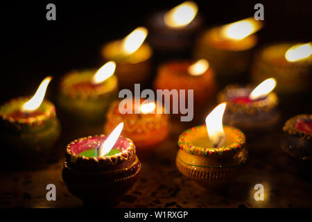 earthen diya lamp lighting with candles on the occasion of diwali and sandhi pujo - Stock Photo