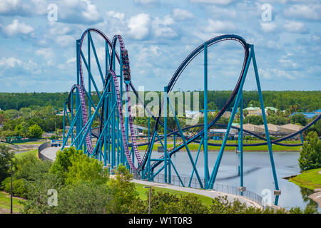 Orlando, Florida.  June 30, 2019 . Panoramic view of people enjoying amazing ride at Mako rollercoaster in Seaworld - Stock Photo