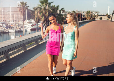 Happy best friends or sisters posing and showing lovely relationship - Stock Photo