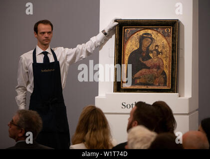 """Sotheby's, London, UK. 3rd July 2019. The summer Old Masters Evening sale offers paintings from the 14th - 19th century by many of the most important painters of Western art. Image: The sale opened with """"The Madonna And Child"""" by Third Master of Anagni which was driven to £735,000 by eight bidders. Dating from the mid-1230s this is the oldest work ever offered in an Old Masters sale at Sotheby's. Credit: Malcolm Park/Alamy Live News. - Stock Photo"""
