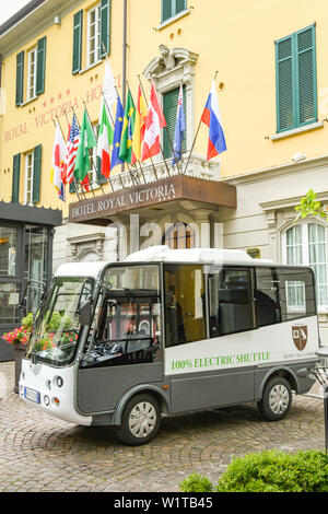 VARENNA, LAKE COMO, ITALY - JUNE 2019: Small electric shuttle vehicle for guests of the Hotel Royal Victoria in Varenna on Lake Como, Italy. - Stock Photo