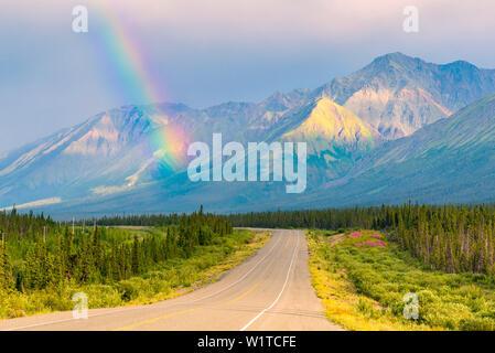 rainbow above Kluane Lake, Yukon Territory, Canada - Stock Photo