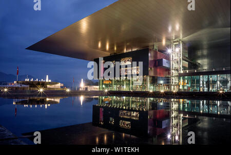 Illuminated fountain and KKL (culture and congress centre of Lucerne) at Europaplatz in the evening, Architect Jean Nouvel, Lucerne, Canton of Lucerne - Stock Photo