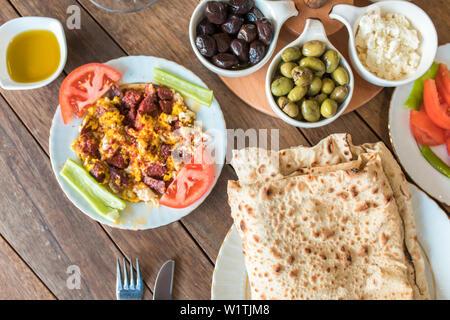 Traditional Turkish Breakfast Table. Turkish Breakfast Food Cuisine Culture. Turkish pide yufka ekmek, tea, bagel, borek, sikma, cheese, olives.