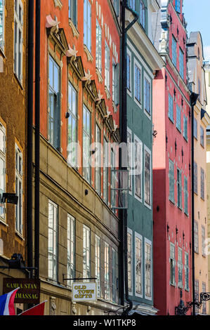 blue sky reflected in windows in alleys of the old town Gamla Stan, Stockholm, Sweden - Stock Photo