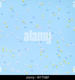 Little stars confetti on blue background. Holyday concept. - Stock Photo