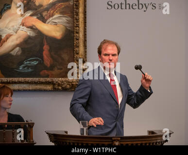Sotheby's, London, UK. 3rd July 2019. The summer Old Masters Evening sale offers paintings from the 14th - 19th century by many of the most important painters of Western art. Highlights include a masterpiece by each of Britain's greatest landscape painters - Turner, Constable and Gainsborough - and extraordinary works from the Baroque by Ribera and the exceptionally rare Johann Liss. Sale total for the evening was £56,205,950 sterling and the auction was taken by Harry Dalmeny, Chairman of Sotheby's UK (pictured). Credit: Malcolm Park/Alamy Live News. - Stock Photo