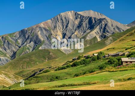 Alpine huts with view towards Pic du Mas de la Grave, Le Chazelet, National Park Ecrins, Dauphine, Dauphiné, Hautes Alpes, France - Stock Photo