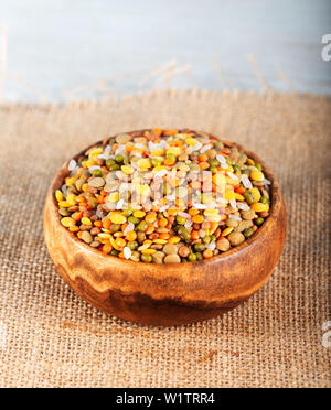 Colorful various beans or lentils and whole grain seeds or cereal in bowl - Stock Photo