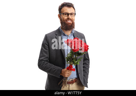 Bearded young man in a holding a bunch of red roses and smiling isolated on white background - Stock Photo