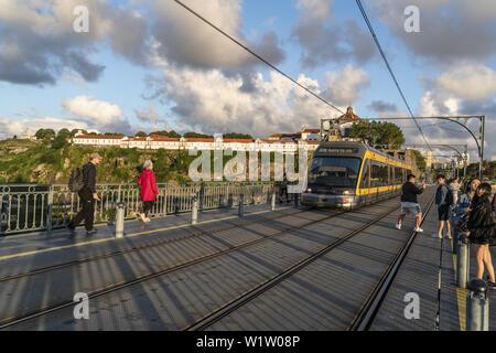 View from Dom Louis I bridge over Douro river, tram, background Mosteiro da Serra do Pilar, Monastry, Porto, Portugal Porto, Portugal - Stock Photo