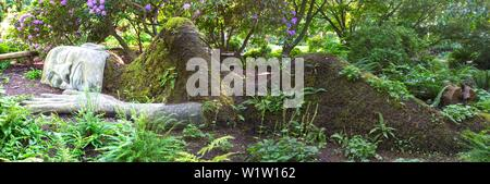 The Moss Lady Art Sculpture of Woman sleeping in soft grass. Victoria BC, Beacon Hill Park, Vancouver Island, Canada - Stock Photo
