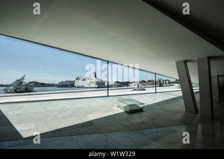 view at cornerstone, sculpture She lies in dockyard and ships, interior of Opera, the New Opera House in Oslo, Norway, Scandinavia, Europe - Stock Photo