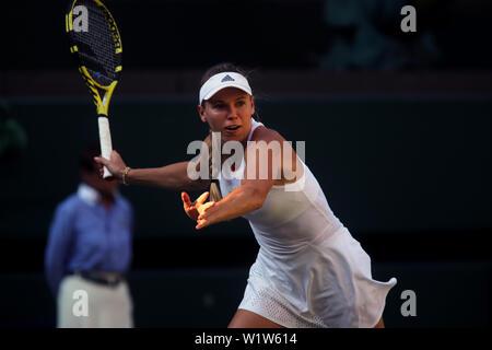 Wimbledon, London, UK. 3rd July 2019. 3 July 2019 - Caroline Wozniacki of Denmark in action against Veronika Kudermetova of Russia at Wimbledon today. Credit: Adam Stoltman/Alamy Live News - Stock Photo