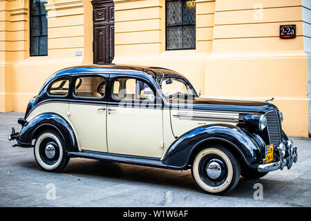 Lodz, Poland, April 21, 2019: vintage glossy and shiny old classic retro car, oldtimer for wedding couple, just married car - Stock Photo