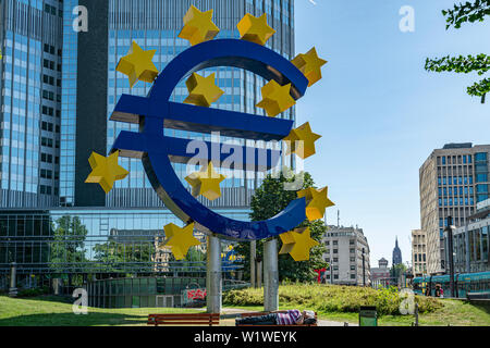 Frankfurt, Germany. July 2019.  the monument of the euro symbol in front of the Eurotorre building - Stock Photo