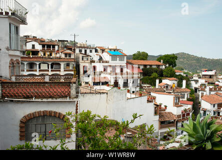 View over white houses in the historical centre of Taxco, Guerrero State, Mexico. Jun 2019 - Stock Photo