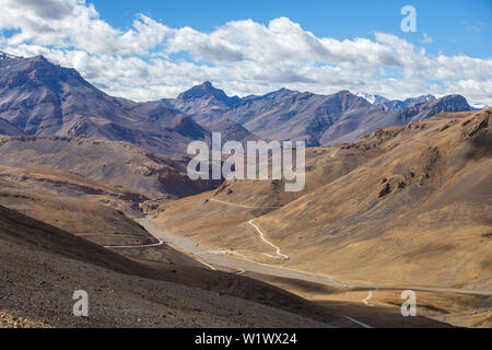 Himalayan mountain landscape along Leh to Manali highway in India. Winding road and majestic rocky mountains in Indian Himalayas, Ladakh, Jammu and Ka - Stock Photo