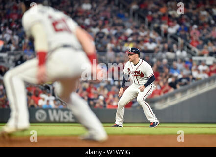 Atlanta, GA, USA. 03rd July, 2019. Atlanta Braves first baseman Freddie Freeman (right) watches the pitcher while looking to steal third base during the sixth inning of a MLB game against the Philadelphia Phillies at SunTrust Park in Atlanta, GA. Austin McAfee/CSM/Alamy Live News - Stock Photo