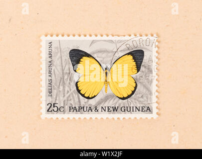 PAPUA NEW GUINEA - CIRCA 1980: A stamp printed in Papua New Guinea shows a butterfly, circa 1980 - Stock Photo