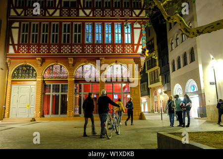 21.10.2018, Frankfurt am Main, Hesse, Germany - Frankfurt Cathedral, the reconstructed Golden Scales House at night in the New Old Town, the DomRoemer - Stock Photo