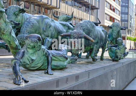Bulls and runners part of the statue dedicated to the San Fermin festival in center of Pamplona - Stock Photo