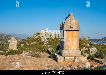Lycian tombs in Kalekoy or Simena, lying on a Lycian way trekking route at the mediterranean coast of Turkey - Stock Photo