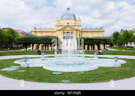 Fontana kralja Tomislava, Fountain of King Tomislav, with Art Pavilion in background, Trg kralja Tomislava, Zagreb, Croatia - Stock Photo